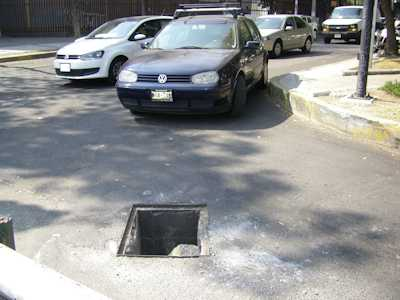 street-hole-with-car-med