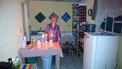 christmas-eve-leslie-lighting-candles-small