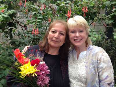 Leslie-and-her-teacher-Aury-with-flowers-sm